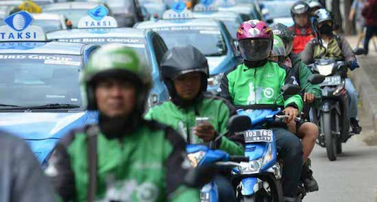 blue bird and gojek as rides in indonesia
