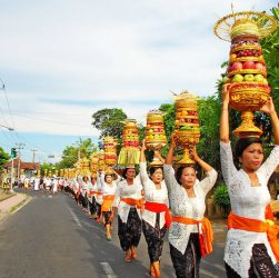 locals in bali walking on the roads